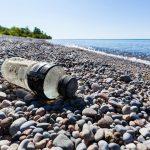 CRX8RT Plastic bottle litter on a Lake Ontario otherwise pristine beach near Second Marsh Wildlife Area in Oshawa Ontario Canada.