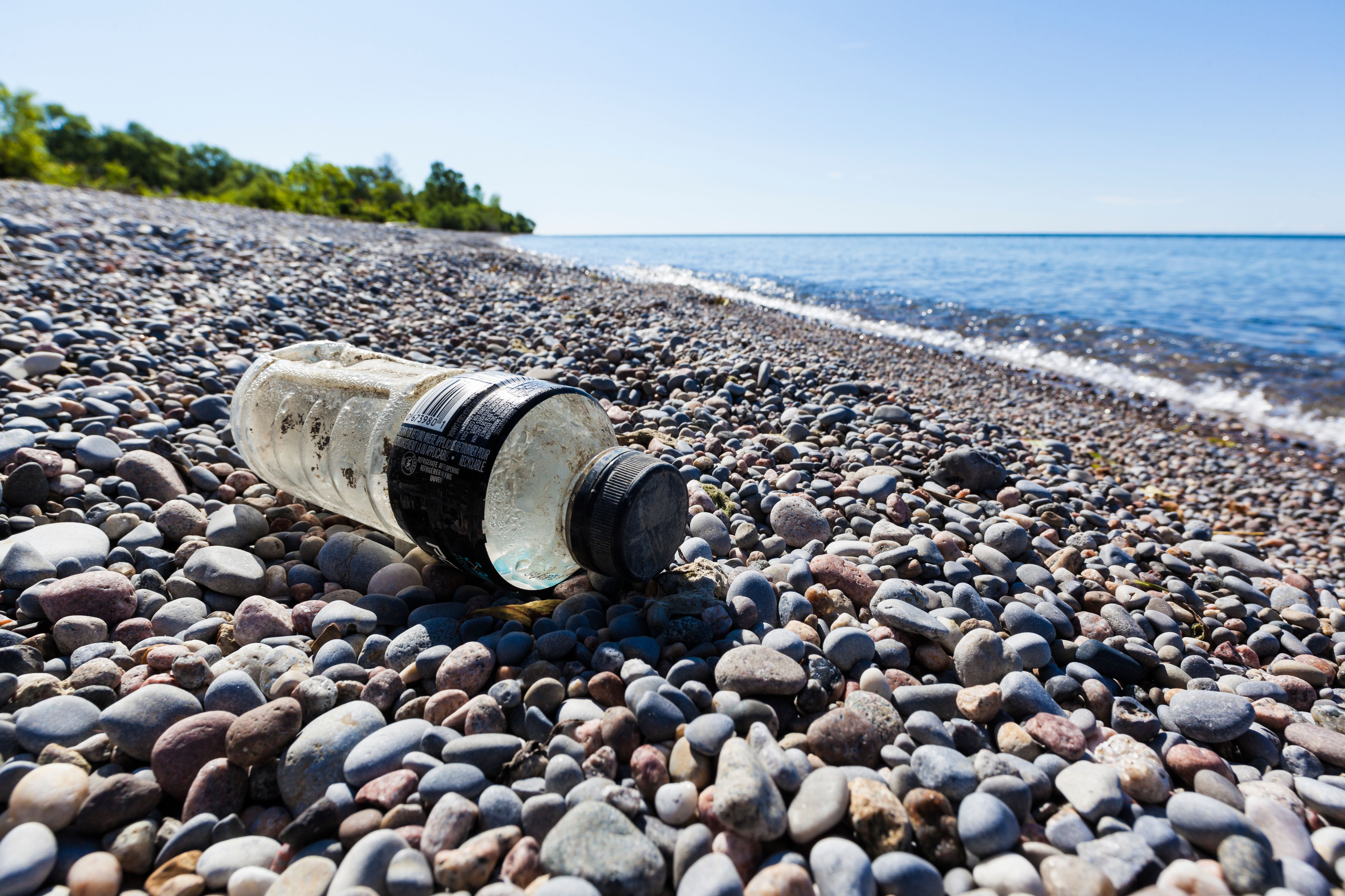 CRX8RT Plastic bottle litter on a Lake Ontario otherwise pristine beach near Second Marsh Wildlife Area in Oshawa Ontario Canada.