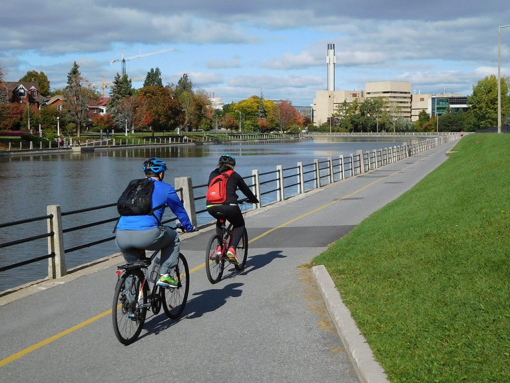 two people cycling by the canal in Ottawa