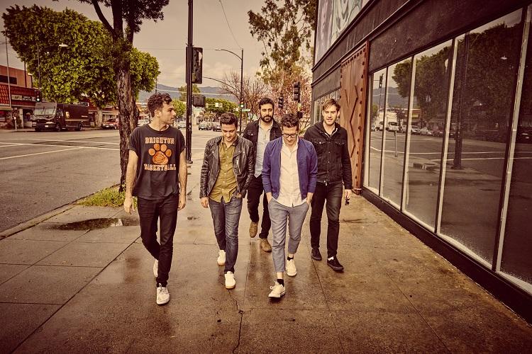 The Arkells band members walking down the sidewalk