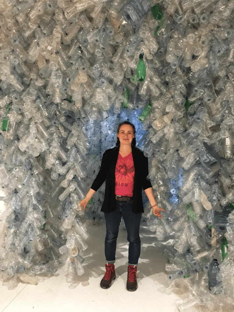 Toronto artist Rebecca Jane Houston with plastic bottle sculpture