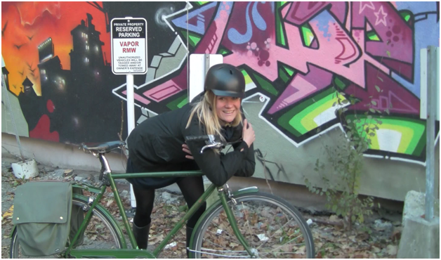 Ashley hugging her bike winter cycling