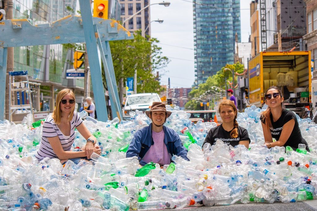 Team Water among the sea of plastic bottles