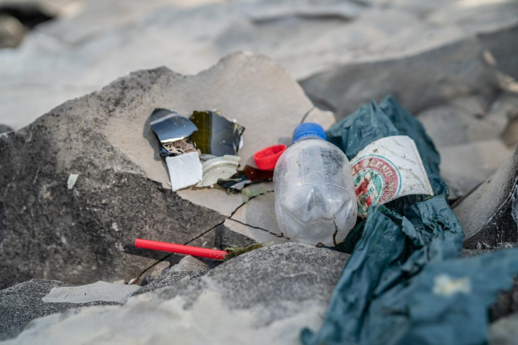 Bits of plastic and a water bottle sat collected from woodbine beach cleanup