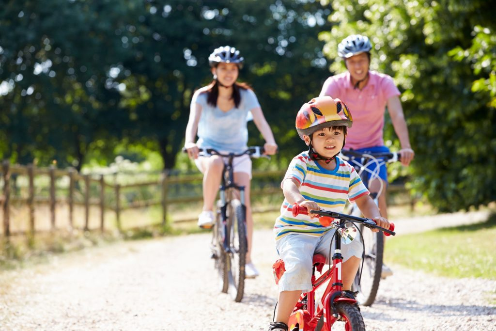 Family cycling outdoors carbon tax is good for Canada