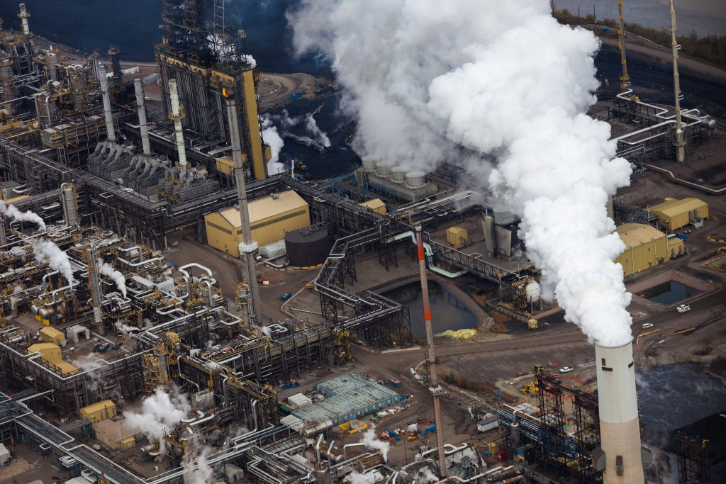 """""""Close-up aerial photo of an oil refinery in the Alberta Oilsands, near Fort McMurray."""""""