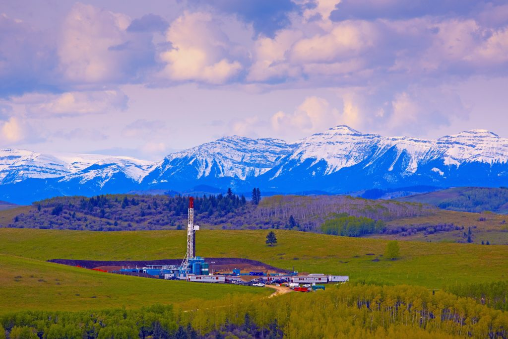 Oil and gas drilling rig in the Rocky Mountain foothills.