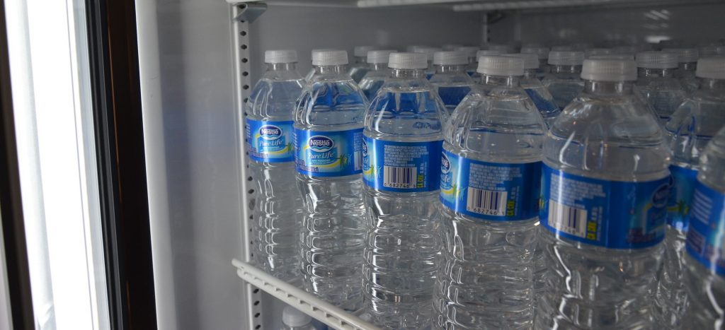 water bottles in a fridge at a store